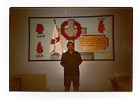 A photograph of Tommy inside the Maze prison: 'Me standing at our mural 2002-2003 in November. Inside the Maze on Remembrance Day.' .