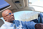 DNA Exonerated prisoner Thomas McGowan, drives his Lexus luxury car near his home in Garland, Texas.