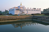 Sun raise at the Maya Devi Temple and pool in Lumbini Nepal..Lumbini marks the birth place of Siddhartha Gautam Buddha.  .In 1976, the Nepalese Government and UNESCO designated Lumbini as a world heritage site..-The full text reportage is available on request in Word format