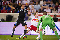 Jason Hernandez (21) of the San Jose Earthquakes knocks Dax McCarty (11) of the New York Red Bulls off the ball during the second half. The New York Red Bulls and the San Jose Earthquakes played to a 2-2 tie during a Major League Soccer (MLS) match at Red Bull Arena in Harrison, NJ, on April 14, 2012.