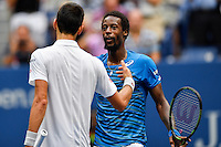 NEW YORK, USA - SEPT 09, Gael Monfils of France shakes hands with Novak Djokovic of Serbia after losing his game during their Men's Singles Semifinal Match of the 2016 US Open at the USTA Billie Jean King National Tennis Center on September 9, 2016 in New York.  photo by VIEWpress