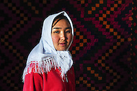 A portrait of the newly married Dinara at her husband's house. Dinara was kidnapped by Ahmat who wanted to marry her. After resisting for 5 hours, she finally accepted. 'I didn't know Ahmad well and didn't want to stay there. But I accepted because this is our tradition' Dinara says. Although illegal, bride kidnapping is common in rural parts of Kyrgyzstan. Each year around 16, 000 women become married after being kidnapped. They are known as 'Ala Kachuu' that translates as 'to grab and run away'. Defenders of the continuation of the practice sight tradition. However, during Soviet Times it was rare, and parents generally arranged marriages..