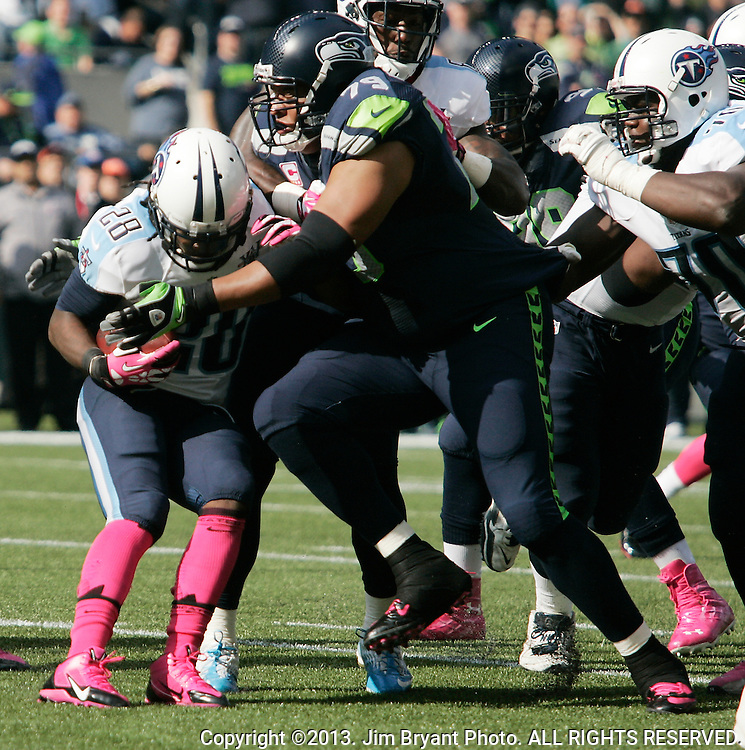 Seattle Seahawks defensive end Red Bryant (79) stops Tennessee Titians running back Chris Johnson for a loss at CenturyLink Field in Seattle, Washington on October 13, 2013. The Seattle Seahawks beat the Titians  20-13.   ©2013. Jim Bryant Photo. All Rights Reserved.