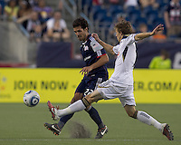 New England Revolution midfielder Benny Feilhaber (22) passes the ball as Philadelphia Union midfielder Brian Carroll (7) defends. In a Major League Soccer (MLS) match, the Philadelphia Union defeated the New England Revolution, 3-0, at Gillette Stadium on July 17, 2011.