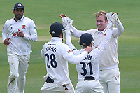 Simon Harmer of Essex is congratulated by his team mates after taking the wicket of Michael Carberry during Essex CCC vs Hampshire CCC, Specsavers County Championship Division 1 Cricket at The Cloudfm County Ground on 21st May 2017