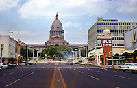 Vintage July 1968 view of downtown Austin, Texas looking up Congress Avenue to the Texas State Capitol and Continental Trailways Bus Station - Stock Image.