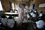 Elizabeth Ryan, a Catholic nun from Ireland, trains teachers in Malakal, Southern Sudan. A sister of the Faithful Companions of Jesus and a member of the Malakal team of Solidarity with Southern Sudan, Ryan is here checking the classroom on one of her student teachers.