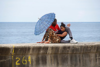 Havana, Cuba. Lovers at Malecon, the famous waterfront..