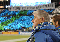November, 2013: CenturyLink Field, Seattle, Washington: Seattle Sounders FC head coach Sigi Schmid looks on as Seattle Sounders FC fans show their support  as the Portland Timbers take on the Seattle Sounders FC in the Major League Soccer Playoffs semifinals Round. Portland led 1-0 at the half.