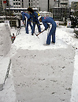 Snow sculpture teams from around the world, use ice picks, chisels and saws to turn blocks of frozen snow into detailed scupltures. These are not traditional Frosty the Snowmen, but huge carved and chiseled Samurai Warriors, Buddhists gods, historical heroes of fairy tales and Walt Disney characters. Some stand as big as buildings. Chiseled out of tons of packed snow, the sculptures are the pride and job of the residents of Sapporo, Japan, who hosts the world famous Ice and Snow Sculpture Festival for five days in early February.Themes of the sculptures are picked from Kabuki stages, historical characters or fairy tales. (Jim Bryant Photo).....