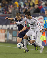 Vancouver Whitecaps FC defender Blake Wagner (19) attempts to control the ball as New England Revolution midfielder Zak Boggs (33) pressures. In a Major League Soccer (MLS) match, the New England Revolution defeated the Vancouver Whitecaps FC, 1-0, at Gillette Stadium on May14, 2011.