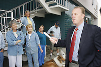 "San Diego Councilmember for District 2, Kevin Faulconer (R) speaks with members of the Point Loma Association about the recent removal of newspaper racks near the Point Loma Post Office in San Diego city, Friday November 16 2007.  The owners of the stands chose to remove the racks rather than comply with a new ordinance passed by San Diego City Council.  Some of the racks found around the city contain magazines and papers that many residents find offensive and lewd.  Others are in disrepair and are not properly maintained by their owners.  The ordinance will apply city-wide and Faulconer credited the Point Loma Association with ""getting the ball rolling"" and said that the rest of San Diego has them to thank for the new laws."
