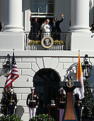 U.S. President Barack Obama (R) and first Lady Michelle Obama (L) wave from the balcony with Pope Francis (C) in an arrival ceremony at the White House on September 23, 2015 in Washington, DC. The Pope begins his first trip to the United States at the White House followed by a visit to St. Matthew's Cathedral, and will then hold a Mass on the grounds of the Basilica of the National Shrine of the Immaculate Conception. <br /> Credit: Win McNamee / Pool via CNP