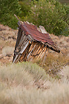 Weathered derelict wooden outhouse