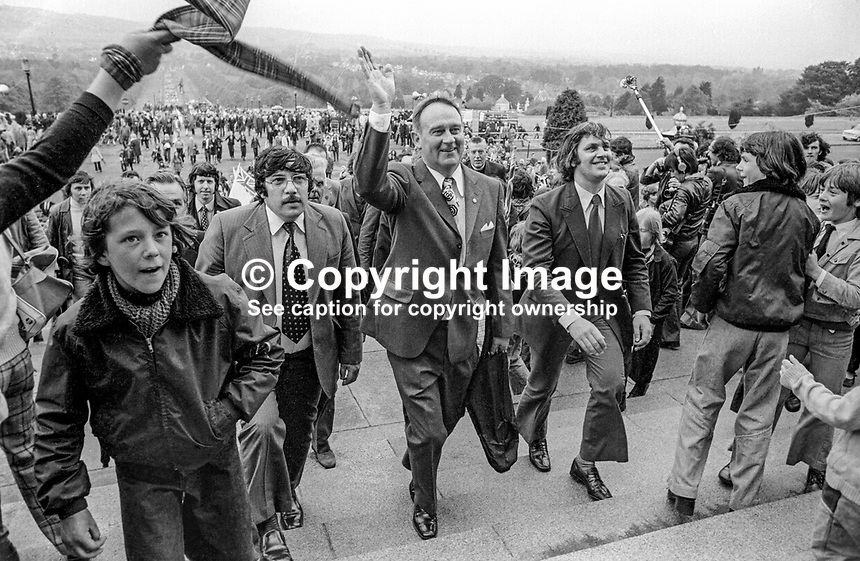 UWC Strike victory rally at Parliament Buildings, Stormont, Saturday, 1st June 1974. William Craig, leader of the Vanguard Unionist Party, is in the middle, with Andy Tyrie, UDA leader Andy Tyrie on the left, and strike committee chairman Glen Barr on the right. Reverend Ian Paisley is behind Craig and Barr. 197406010331e<br /> <br /> Copyright Image from Victor Patterson, 54 Dorchester Park, <br /> Belfast, UK, BT9 6RJ<br /> <br /> t1: +44 28 9066 1296 (from Rep of Ireland 048 9066 1296)<br /> t2: +44 28 9002 2446 (from Rep of Ireland 048 9002 2446)<br /> m: +44 7802 353836<br /> <br /> e1: victorpatterson@me.com<br /> e2: victorpatterson@gmail.com<br /> www.victorpatterson.com<br /> <br /> Please see my Terms and Conditions of Use at www.victorpatterson.com. It is IMPORTANT that you familiarise yourself with them.<br /> <br /> Images used on the Internet must be visibly watermarked i.e. &copy; Victor Patterson<br /> within the body of the image and copyright metadata must not be deleted. Images <br /> used on the Internet have a size restriction of 4kbs and will be chargeable at current<br />  NUJ rates unless agreed otherwise.<br /> <br /> This image is only available for the use of the download recipient i.e. television station, newspaper, magazine, book publisher, etc, and must not be passed on to any third <br /> party. It is also downloaded on condition that each and every usage is notified within 7 days to victorpatterson@me.com<br /> <br /> The right of Victor Patterson to be identified as the author is asserted in accordance with The Copyright Designs And Patents Act (1988).