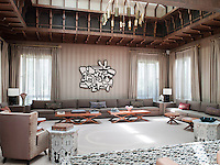 In the main living area the graphic modern artwork was sourced via one of Prince Faisal's friends in Los Angeles and the circular and rectangular Mine Occasional Tables in solid oak are from Christopher Hall's own 'Retrograd' collection