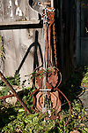 """A """"guitar"""" made from rusty old saw blade, auto, and boat parts and debris."""