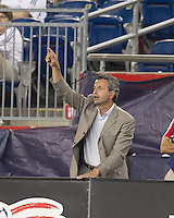 Chicago Fire head coach Frank Clopas signals team. In a Major League Soccer (MLS) match, the New England Revolution tied the Chicago Fire, 1-1, at Gillette Stadium on June 18, 2011.