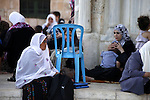 Palestinians sit at Al-Aqsa mosque compound during a waiting to break their fast in the old city of Jerusalem during the fasting month of Ramadan on July 31, 2012. Photo by Saeed Qaq