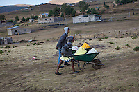 9 May 2011, Semonkong, Semonkong Community Council, Maseru District, Lesotho. Children playing and fetching water at the end of the day.