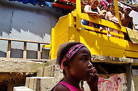 A Brazilian girl talks in front of her family in Rocinha, the largest slum in Rio de Janeiro, 28 February 2004.