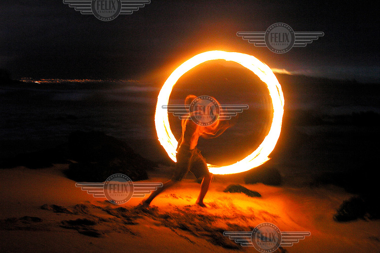 Fire dancer on the beach. Maui is famous for its youth party culture.