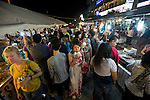 Visitors and locals walk through the weekly night market in Garapan, Saipan.  .Robert Gilhooly Photo