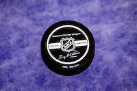 5 October 2005:  New National Hockey League official game puck on the ice at the start of the new 2005-2006 NHL season after a year long lockout. Detail product shot with new logo.