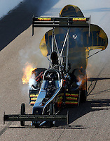 Feb 21, 2014; Chandler, AZ, USA; NHRA top fuel dragster driver Troy Buff has fire during qualifying for the Carquest Auto Parts Nationals at Wild Horse Pass Motorsports Park. Mandatory Credit: Mark J. Rebilas-USA TODAY Sports