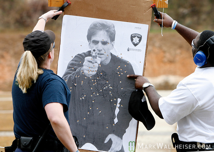 Two of the dozen new TPD recruits replace one of the targets as they go through the firearms training at the Pat Thomas Law Enforcement Academy  January 09, 2007. (Mark Wallheiser/TallahasseeStock.com)