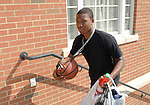 Ohio University student Melvin Spears moves his basketball into Adams Hall Sunday afternoon.