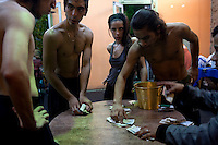 Ceci (centre right) stands with other tango dancers as they split the tips earned from customers at the end of the night at a restaurant in the El Caminito area of Buenos Aires.