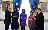 United States President Barack Obama (L) takes the oath of office from U.S. Supreme Court Chief Justice John Roberts as first lady Michelle Obama holds the bible and their daughters Malia and Sasha (L-R) look on in the Blue Room of the White House in Washington, January 20, 2013. .Credit: Larry Downing / Pool via CNP