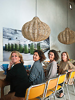 Portrait of Carina Casanovas and Maria Llado,  along with two friends sitting at the dining room table
