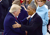 United States President Donald J. Trump embraces former US President Barack Obama after being sworn-in as the 45th President of the United States on the West Front of the US Capitol on Friday, January 20, 2017.<br /> Credit: Ron Sachs / CNP<br /> (RESTRICTION: NO New York or New Jersey Newspapers or newspapers within a 75 mile radius of New York City)