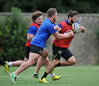Guy Mercer of Bath Rugby takes on the defence. Bath Rugby training session on August 4, 2015 at Farleigh House in Bath, England. Photo by: Patrick Khachfe / Onside Images