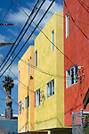 Brightly painted office buildings and power lines in alley near Abbot Kinney Blvd. in Venice, California