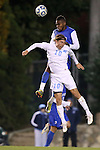 06 November 2012: Duke's Sebastien Ibeagha (behind) heads the ball over UNC's Andy Craven (10). The University of North Carolina Tar Heels defeated the Duke University Blue Devils 1-0 at Fetzer Field in Chapel Hill, North Carolina in a 2012 NCAA Division I Men's Soccer game. The game was an Atlantic Coast Conference quarterfinal match.