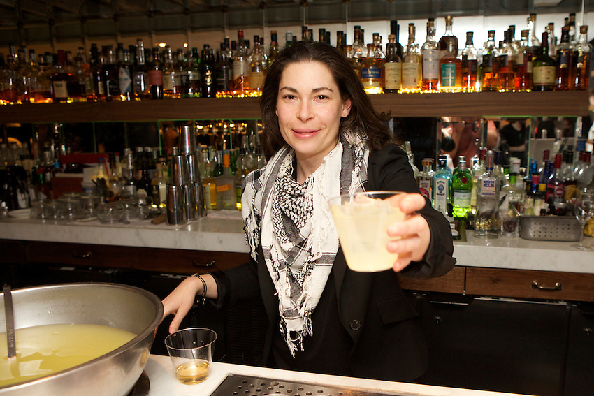 New York, NY - March 30, 2015: A bartender serving punch at Staff Meal, a fundraiser for Heritage Radio Network, at All'onda, near Union Square. <br /> <br /> CREDIT: Clay Williams for Heritage Radio Network.<br /> <br /> &copy; Clay Williams / claywilliamsphoto.com
