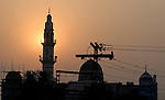 The minaret of a mosque at sunset in Lahore, Pakistan....