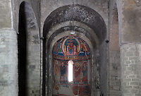 Central apse with mural paintings (replicas) depicting the Virgin and Child with the Magis and window of Santa Maria de Taull Church, 1123, consecrated by Ramon Guillem, the bishop of Roda, Taull, Province of Lleida, Catalonia, Spain. The church was built with three naves, each ending with an apse. It was heavily renovated in the 18th century. Its frescoes were removed to the MNAC (National Art Museum of Catalonia, Barcelona) circa 1918. Santa Maria de Taull Church is part of the Catalan Romanesque churches of the Vall de Boí which were declared a World Heritage Site by UNESCO in November 2000. Picture by Manuel Cohen