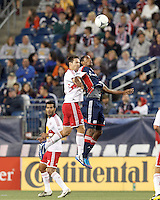 New York Red Bulls defender Heath Pearce (3) and New England Revolution forward Jerry Bengtson (27) battle for head ball. Despite a red-card man advantage, in a Major League Soccer (MLS) match, the New England Revolution tied New York Red Bulls, 1-1, at Gillette Stadium on September 22, 2012.