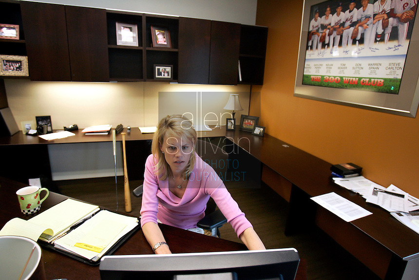 Molly Fletcher works in her office at Career Sports and Entertainment on Wednesday morning, March 22, 2006. Fletcher must juggle her busy family life --she has a husband and three children--with a more than full-time job representing several top sports personalities.<br />