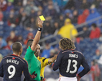 Yellow card for Jermaine Jones.Foxborough, Massachusetts - October 4, 2014: In a Major League Soccer (MLS) match, the New England Revolution (blue/white) defeated Columbus Crew (yellow), 2-1, at Gillette Stadium.