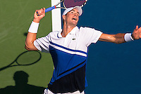NEW YORK, NY - August 27, 2013: John Isner (USA) serves during his first round single's match at the 2013 US Open in New York, NY on Tuesday, August 27, 2013.