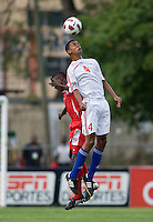 Adrian Diz (4) of Cuba goes up for a header against Alexander Gonzalez (20) of Panama during the group stage of the CONCACAF Men's Under 17 Championship at Jarrett Park in Montego Bay, Jamaica. Panama tied Cuba, 0-0.