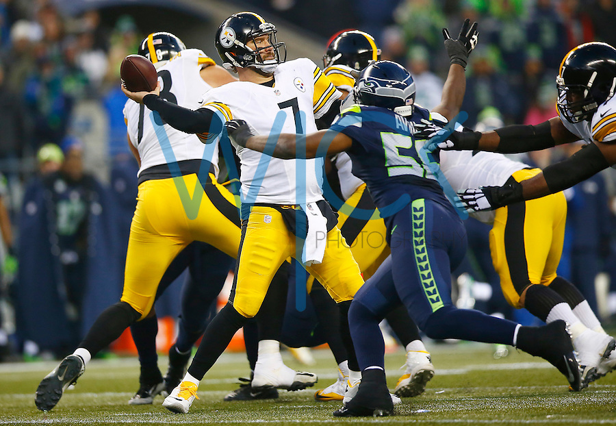 Ben Roethlisberger #7 of the Pittsburgh Steelers throws a pass in front of a rushing Cliff Avril #56 of the Seattle Seahawks in the second half during the game at CenturyLink Field on November 29, 2015 in Seattle, Washington. (Photo by Jared Wickerham/DKPittsburghSports)