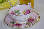 A teacup sits on a table.