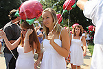 Delta Zeta sorority pledges walk through a tunnel of fraternity members while on their way to their sorority houseduring the 2011 sorority bid day event on Thursday, August 18, 2011. Photo by Brandon Goodwin | Staff