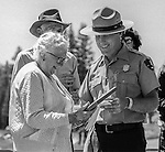"Tuolumne Meadows, August 24, 1985:  Yosemite National Park Superintendent Bob Binneweis presents plaque to Virginia Best Adams.  Mount Ansel Adams, an 11,700 foot peak in a remote section of Yosemite National Park was dedicated Saturday, August 24, 1985, in a ceremony recognizing the famed photographer for his contribution to the American conservation movement. Adams was eulogized as a man who dedicated his life to photography and the preservation of planet Earth. The dedication ceremony was led by Adams' son, Dr. Michael Adams of Fresno, and attended by Adams' widow, Virginia Adams, Secretary of the Interior Donald Hodel, Sen. Alan Cranston, D-California, National Park Service Director William Penn Mott, actor Robert Redford, and other environmental and conservation leaders. In 1932, Ansel Adams and several Sierra Club companions first climbed the peak, according to Virginia Adams, who added that ""Ansel loved its tower shape. He called it 'The Tower' on the Lyell Fork of the Merced River. After they came down from climbing it, they sat around the campfire and one of them suggested that they name it Mount Ansel Adams."" Informally, that is what the Sierra Club did, calling the peak Mount Ansel Adams in the Sierra Club Guide until 53 years later the peak was finally officially named.  Photo by Al Golub/Golub Photography"